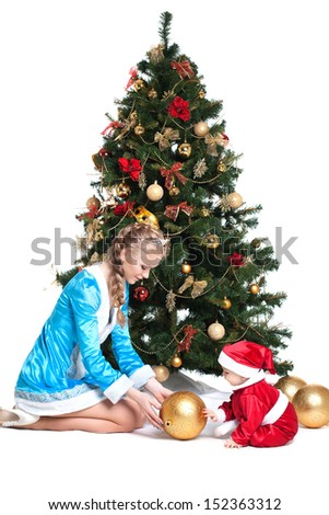 Snow Maiden and baby-Santa with Christmas tree - stock photo