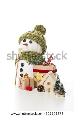 snow man with christmas decoration - stock photo