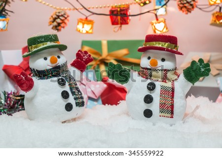 Snow man with the ornament, gift present, wait Santa Claus in Merry christmas and Happy New year Night