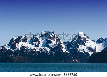 Snow melting on mountains in Alaska - stock photo
