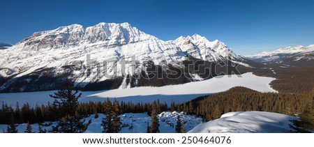 Snow Mountain and Frozen Lake in Canadian Rockies - stock photo