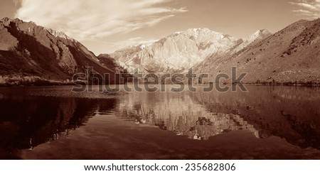 Snow mountain and lake BW with reflections panorama in Yosemite. - stock photo