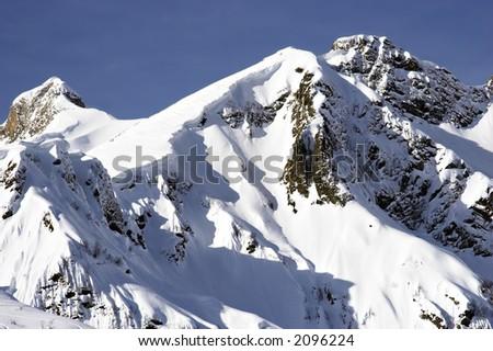 snow mountain peaks - stock photo