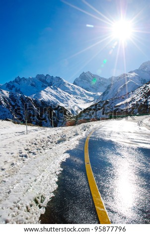 Snow mountain road - stock photo
