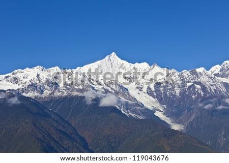 Snow mountains in autumn - stock photo