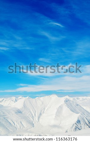 Snow mountains on bright winter day - stock photo