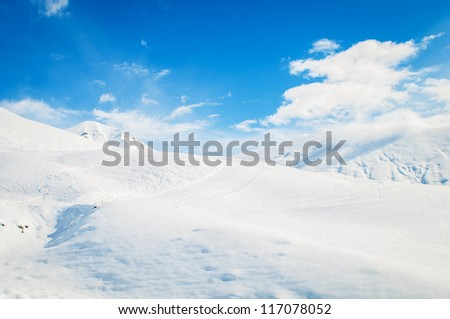 Snow mountains on bright winter day - stock photo