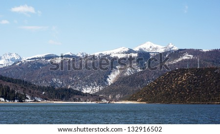 snow mountains with the forests and lake in Yunnan ,Shangrila or Shangri La - stock photo