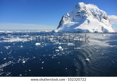 Snow mountans in Antarctica near the water. Beautiful background - stock photo
