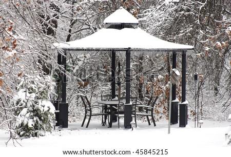 Snow on gazibo - stock photo