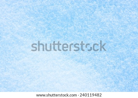 Snow on ice, blue tone - texture or background - stock photo