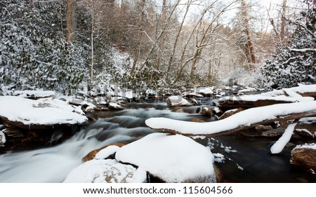 Snow on the rocks, stream in the smokey mountains national park - stock photo
