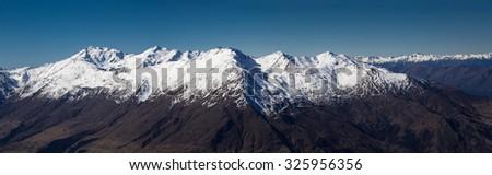 Snow on top of Mount Alta / Mount Aspiring National Park - stock photo