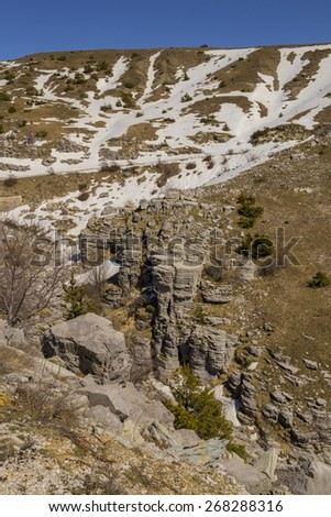 snow on Vradeto village in Ioannina perfectrure Greece - Pindus mountain - spring time - stock photo