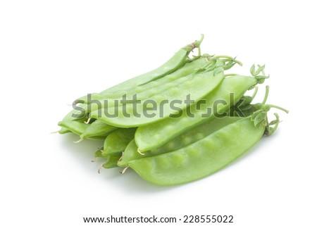 snow peas on white background - stock photo