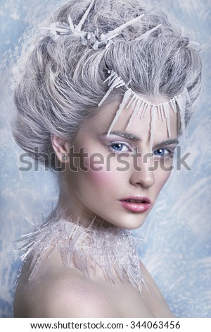 Snow Queen, creative closeup portrait. Young woman in creative image with silver artistic make-up. Winter Portrait. - stock photo