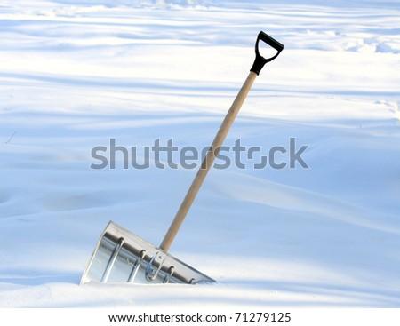 Snow removal metal shovel - stock photo