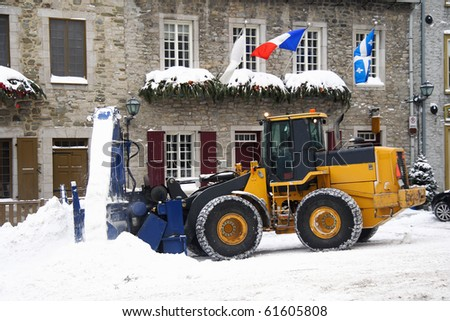 Snow removal vehicle removing snow after blizzard in Quebec City, Canada.