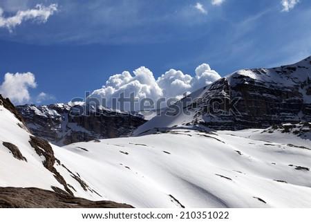 Snow rocks and cloudy blue sky. Turkey, Central Taurus Mountains, Aladaglar (Anti Taurus) view from plateau Edigel (Yedi Goller) - stock photo
