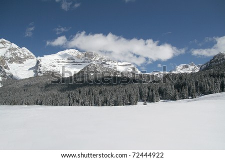 Snow scene panorama of winter mountains - stock photo