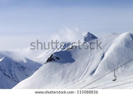 Snow slope and ropeway. Caucasus Mountains, Georgia, ski resort Gudauri. - stock photo
