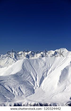 Snow slope in high mountains. Caucasus Mountains, Georgia, view from ski resort Gudauri. - stock photo
