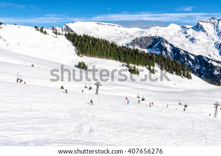 Snow slope in mountain with small slopes for beginners. Ski resort in Alps Switzerland, ''Jungfrau''. - stock photo