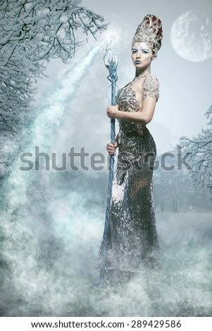 Snow sorceress with magic staff - stock photo