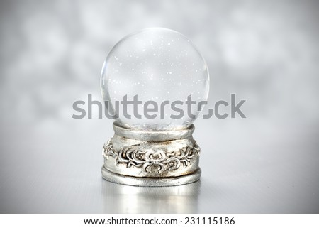 snow space and glass ball in xmas time  - stock photo