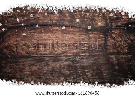 Snow stars on wooden background - stock photo