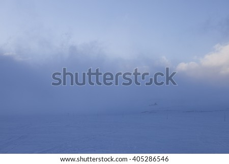 Snow storm beginning  in the norwegian mountains at winter time. Troms.