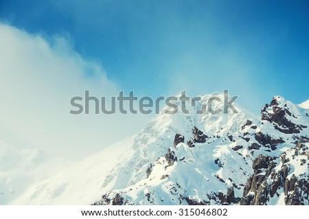 Snow storm in the mountains. Beautiful winter landscape