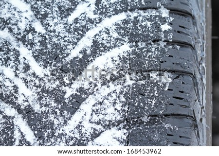 Snow tire (Snow tyre) in winter - stock photo