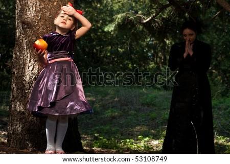 snow white little girl eat poison apple - stock photo