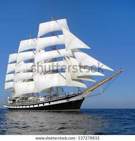 Snow-white sails of the ship - stock photo
