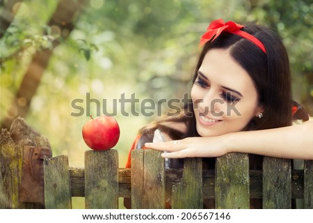 Snow White with Red Apple Fairy Tale Portrait - Young Snow-White princess with the famous red apple   - stock photo