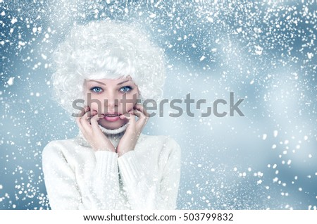 Snow winter young woman in long white dress fashion portrait