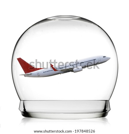 Snowball travel concept with a plane representing holidays - stock photo