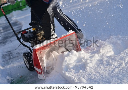 snowblower in winter - stock photo