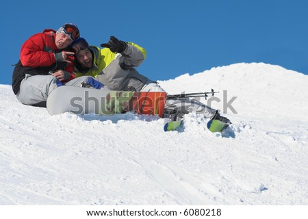 Snowboard and ski friends on snow. Winter sport lifestyle concept - stock photo