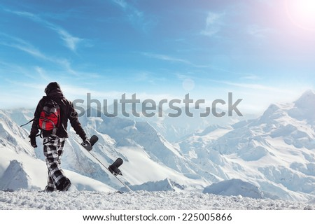 Snowboard freerider in the mountains with helmet