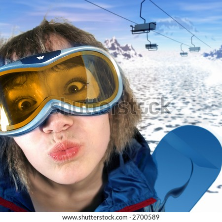 snowboard girl fun kiss  over the mountain background - stock photo