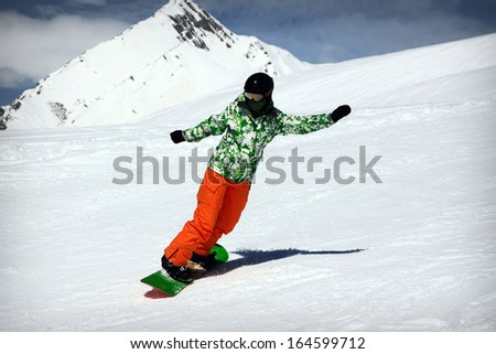 Snowboard girl ride at mountains - stock photo