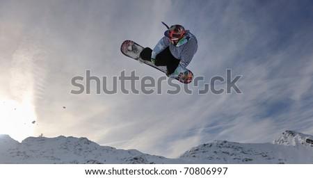 snowboard winter sport  extreme jump - stock photo
