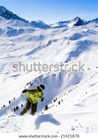Snowboarder and mountain. Ski resort Les Arcs. France