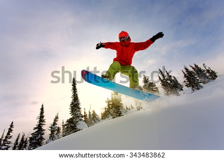 Snowboarder doing a toe side carve - stock photo
