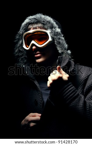Snowboarder fashion portrait on black
