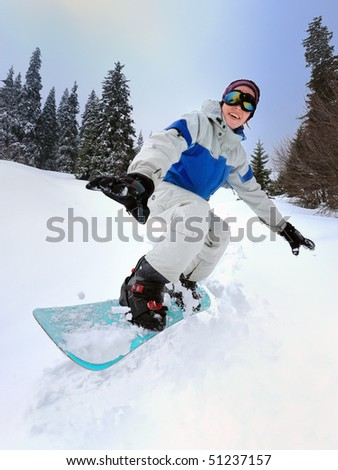 Snowboarder girl riding down - stock photo
