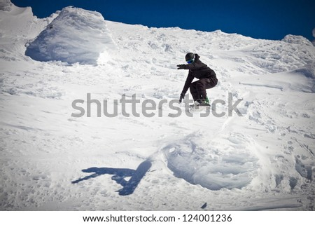 Snowboarder in Mid Air Jump