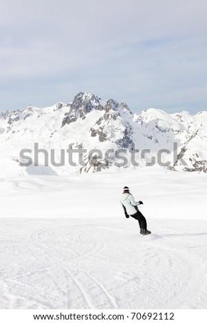 Snowboarder in snow mountain landscape. Alps. France. Saint Jean d'Arves. - stock photo